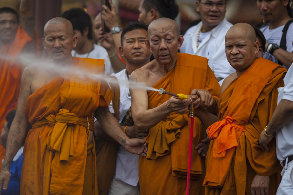 RAINED UPON: Buddhist monks jet holy water onto devotees at the end of the festival.