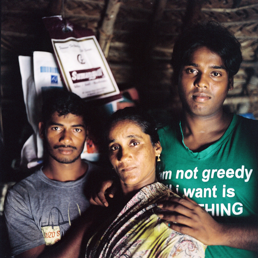 SUPPORT: Laksheaya (far right) poses with her mother and brother in their house in Devenappatinam. In Laksheya's rare case, her family is extremely supportive of her gender identity.