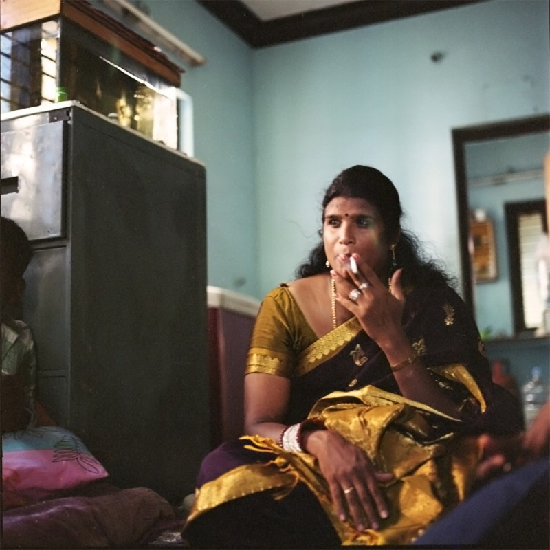 Sheethal smokes a cigarette in her apartment in Pondicherry. Sheethal acts as a guru to many of the younger kothis in this community who refer to her as their mother and she to them as her daughters.