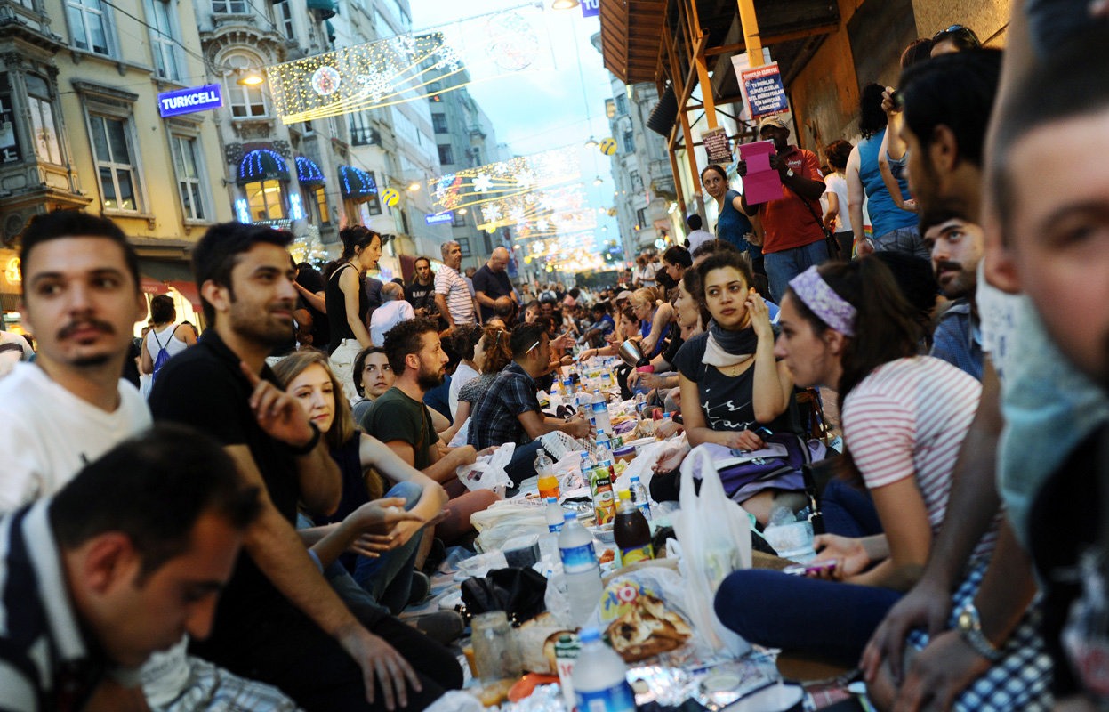 Turkish anti-government protesters gather as they break their first day of fasting for the Muslim holy month of Ramadan on Istiklal street.