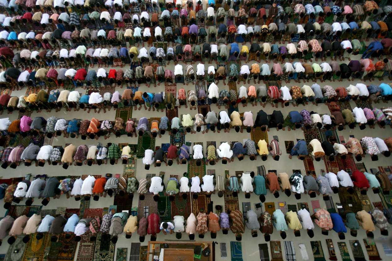 Students perform an afternoon prayer on the first day of the holy fasting month of Ramadan, at Ar-Raudlatul Hasanah Islamic boarding school in Medan, North Sumatra, Indonesia.