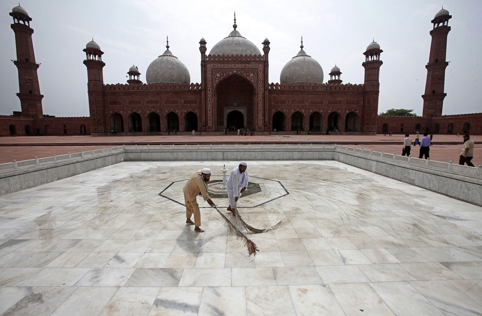 Workers clean the floor of the Badshahi Mosque ahead of the holy month of Ramadan in Lahore, Pakistan, on July 9, 2013.
