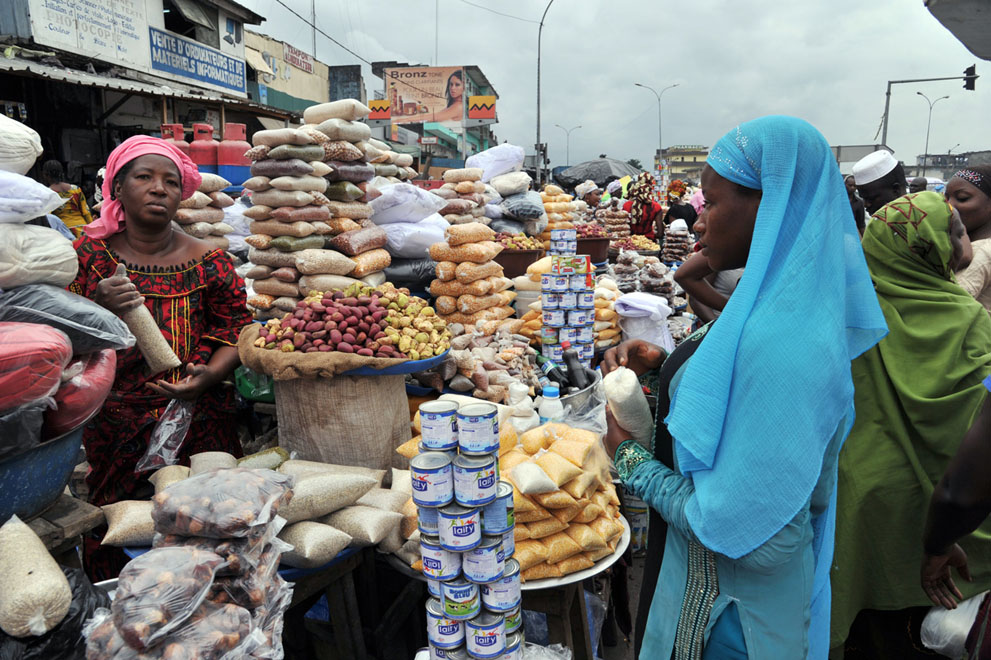 A woman sells dates and cereals in a street market in Abobo, suburb of Abidjan, Cote d'Ivoire, on July 9, 2013, on the first day of Ramadan.
