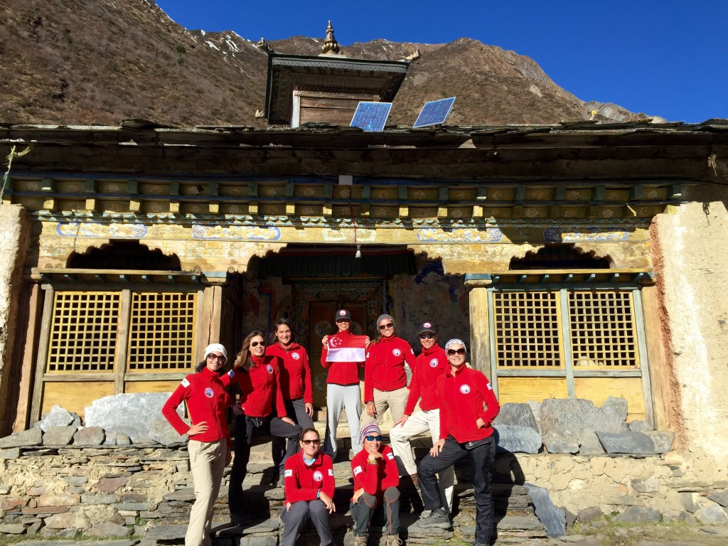 The WOAM team posing in front of the Mu Gompa monastery