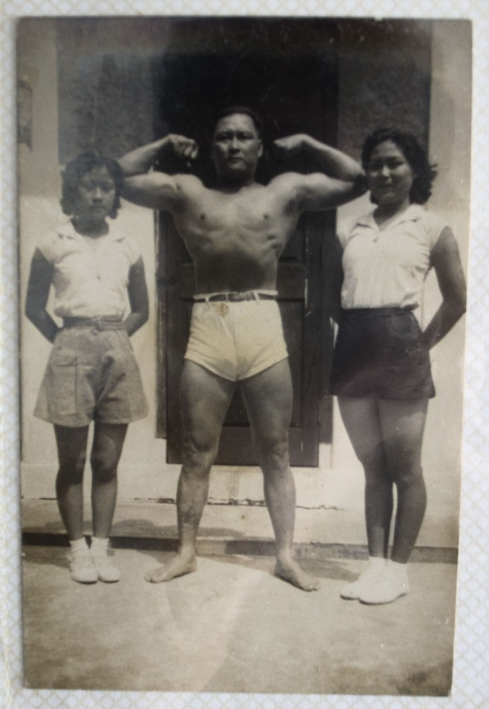 Father Ho strikes a pose as his daughters stand beside him. Tai Ma is on the right.