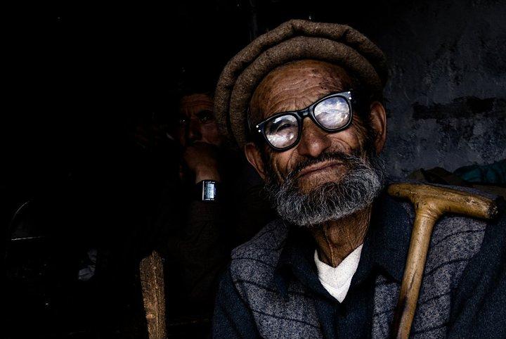 Man looking at a mountain_On the way to Nanga Parbat base camp_Northern Areas_Pakistan