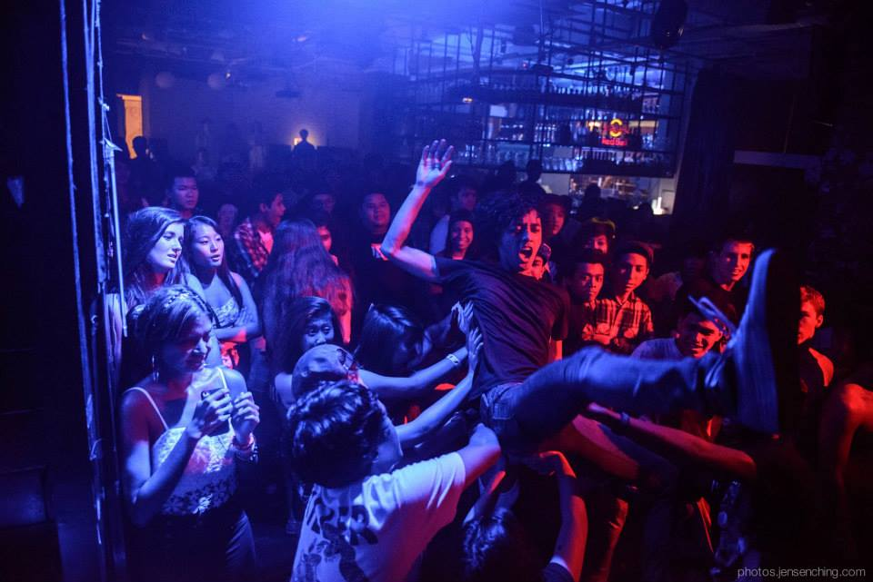 A crowdsurfer during an event at Home Club, Singapore.