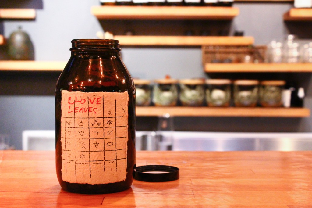 A bottle of foraged clove leaves Vijay dehydrated and keeps behind the bar