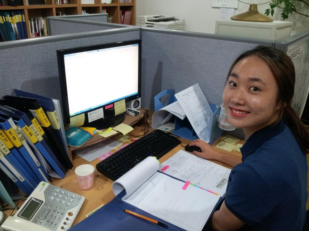 Hanna at her desk
