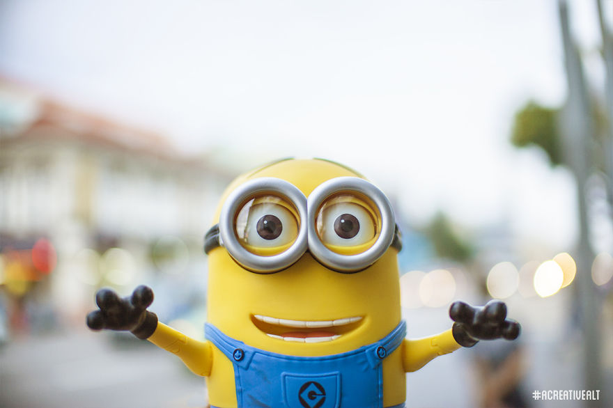 photographer imagines minions as tourists in singapore contented